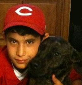 headshot of Christian Anthony Fernandez, with his dog 'Fiona'